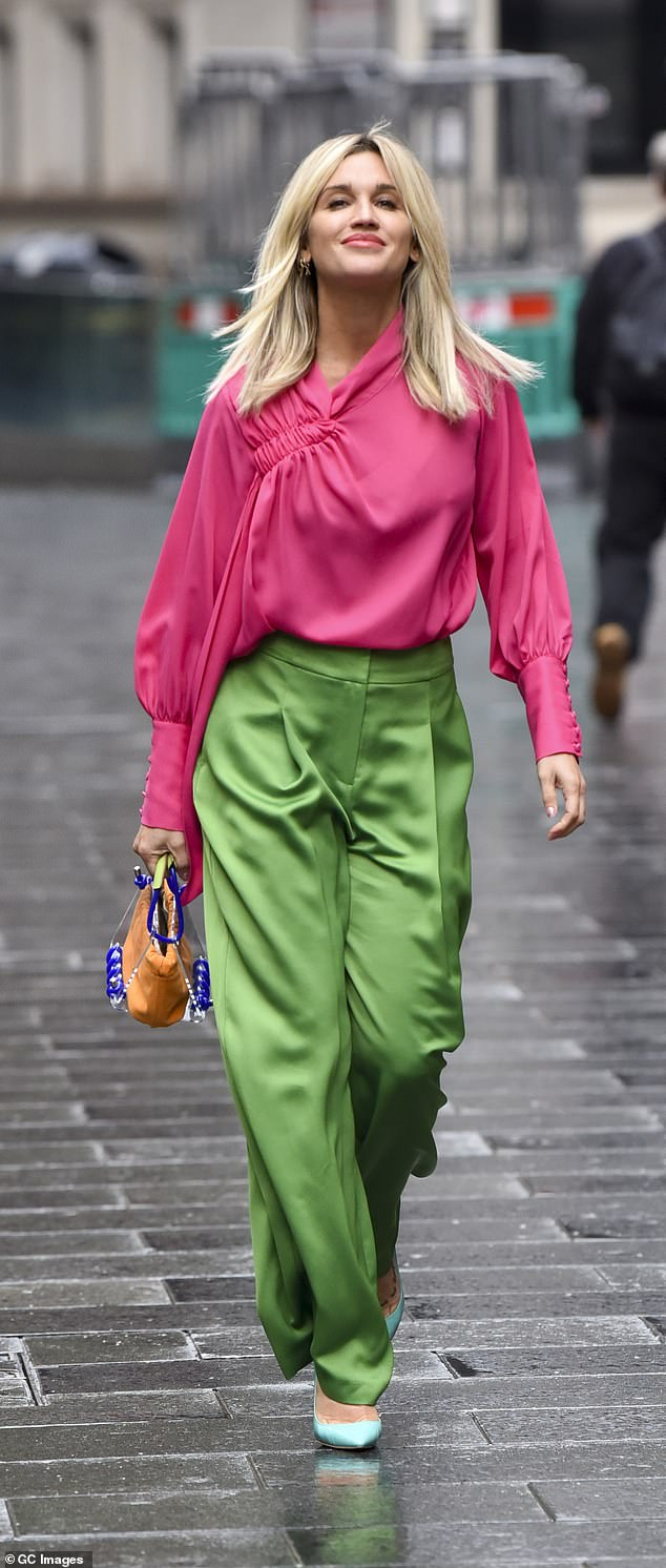 Wow!Ashley Roberts truly lit up the grey streets of London on Monday as she headed home from her radio show in a pink and green satin ensemble
