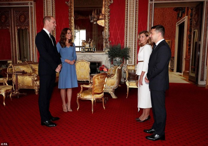 During the brief reunion, the couples stood socially distanced in the throne room (pictured) before moving to two separate ornate sofas to continue their conversation They didn't shake hands like they would have before the lockdown