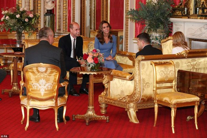 The Duke and Duchess of Cambridge meet with Ukrainian President Volodymyr Zelenskyy and his wife, Olena. The couple moved to the sofas (pictured) during the brief hearing