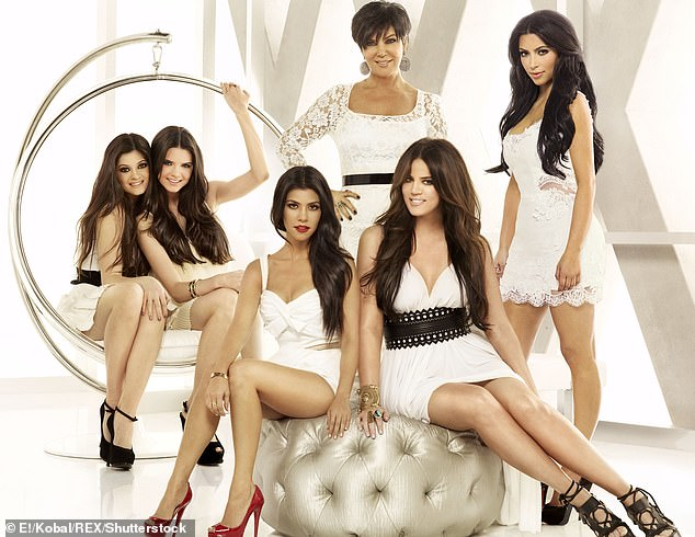 Evolution: the KUWTK family seen posing together for a promo in 2007;  Khloe is sitting on a cushion in the lower right
