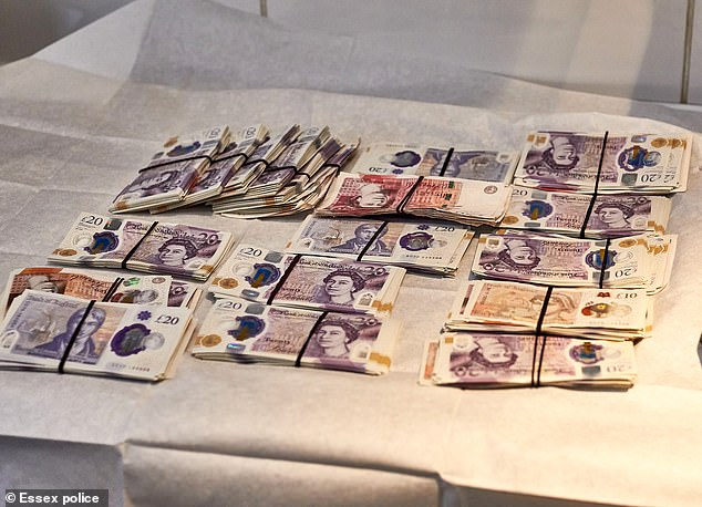 Members of the network are said to have started using Bitcoin after running out of places to hide profits of up to £90,000 a day (money found during the raid pictured)