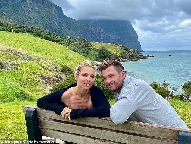 Gorgeous: Chris also shared a cute photo of himself cuddling up to his wife Elsa Pataky with the breathtaking scenery of Lord Howe Island behind