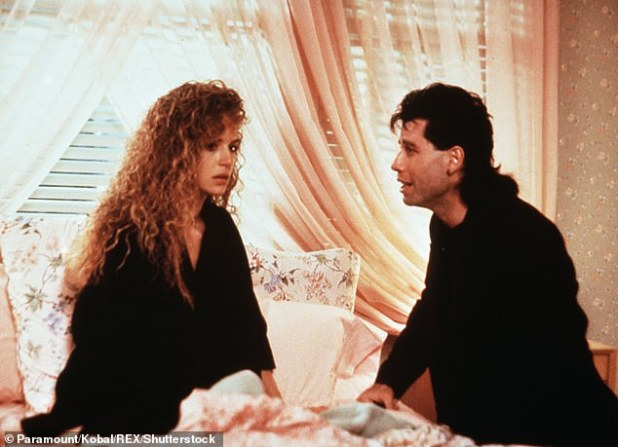 On screen: John and Kelly met and began dating the 1989 film The Experts;  He proposed on the New Year's Eve 1991 at the Palace Hotel in Gstad, Switzerland