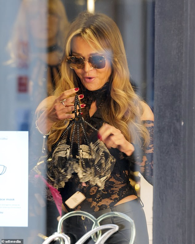 Dressed up: The TV personality dressed to impress as she perused some of the racy items on offer atAgent Provocateur