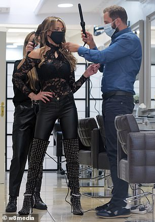 Perfect: She teamed the look with leather trousers and knee-high boots covered with silver studs