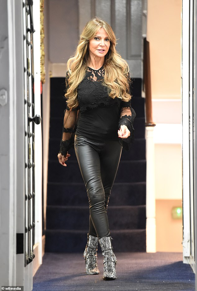 Sexy:Lizzie Cundy cut a glamorous figure in tight leather trousers as she treated herself to new underwear in west London on Tuesday