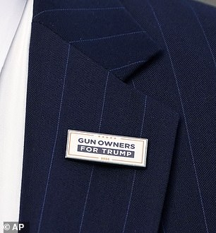 Mark McCloskey pictured wearing a 'Gun Owners for Trump' pin