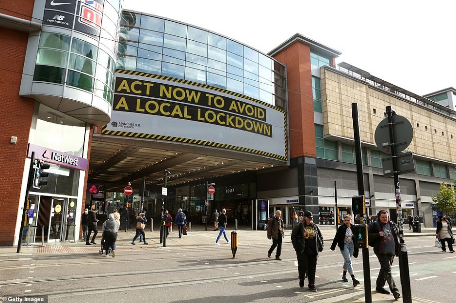 Mayor Burnham and its local council leaders earlier threatened legal action if the city is plunged into the 'fundamentally flawed' highest level of local restrictions without more financial help. He said he would 'not cave into the pressure' by agreeing to a local lockdown and said the extreme restrictions would be 'by imposition, not consent'. Pictured:Manchester City Centre on October 14