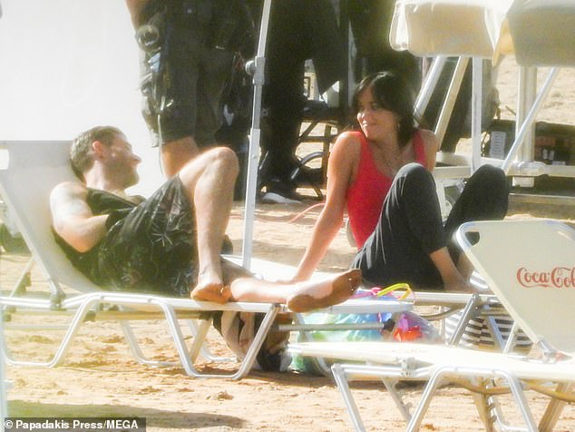 Relaxed: The duo were seen engaging in an animated conversation on deck chairs