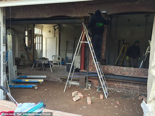 The couple spent months knocking down walls, building into the loft and extending in order to create more space. Pictured, the house during the extensive renovations