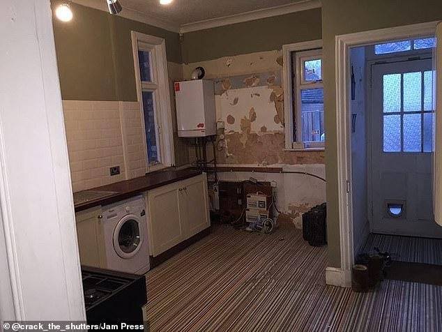 The dark utility room in the property before the extensive renovations