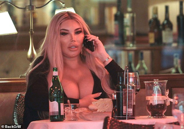 Table for one: The former Celebrity Big Brother star, 37, turned heads as she slipped into a form-fitting black jumpsuit, which drew attention to her cleavage