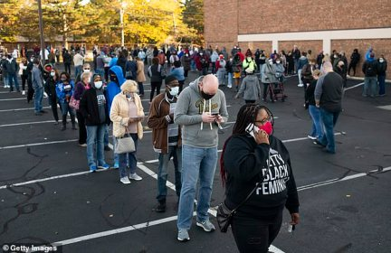 OHIO:Early voters line up outside of the Franklin County Board of Elections Office last week