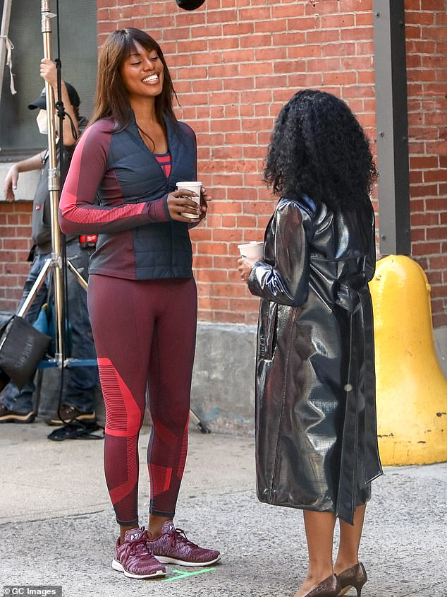 Woman in red: Laverne Cox was also on set to play the personal trainer and life coach Kacy Duke. She played a convincing trainer by showing off her fit figure in red patterned leggings, burgundy trainers and a red and navy jacket