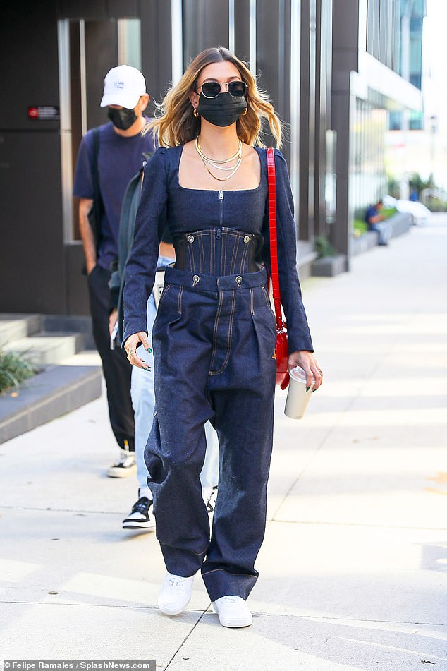 Cover girl:Hailey Bieber turned a Brooklyn, New York sidewalk into her own personal catwalk as she stepped out Thursday in a utility inspired ensemble