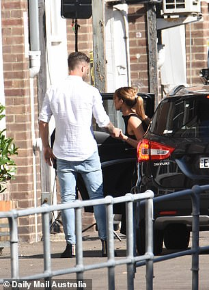Proving himself to be quite the gentleman, former rising AFL star Jake Edwards, (pictured) was seen helping his date from the car, offering a hand of support