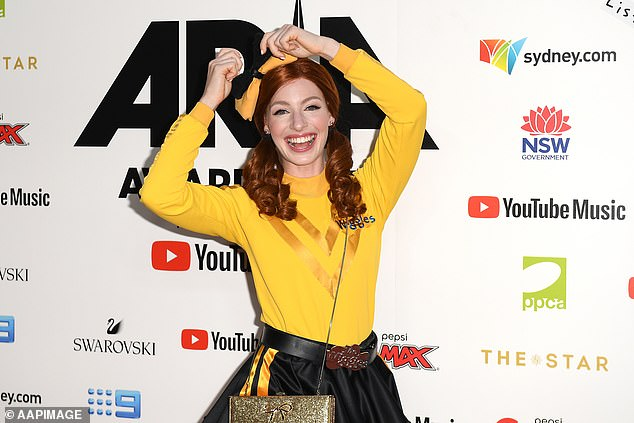 Iconic costume: Emma Watkins (pictured), a.k.a. the 'Yellow Wiggle', wears a costume that features a yellow skivvy, a matching bow, and a black-and-yellow tutu