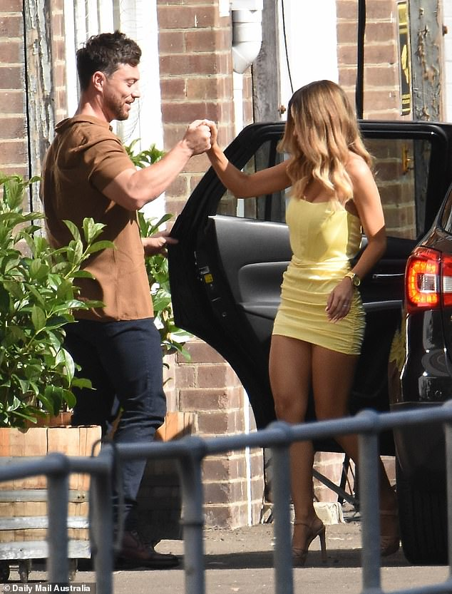Style: He opted for a smart-casual look brown button-up shirt, black jeans and leather shoes. His partner stunned in a yellow mini dress and cream coloured heels