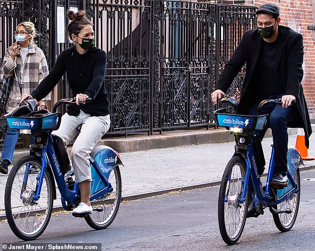 Romantic ride: They also enjoyed the brisk autumn New York weather, as they checked out some Citi Bikes for a romantic ride through the city