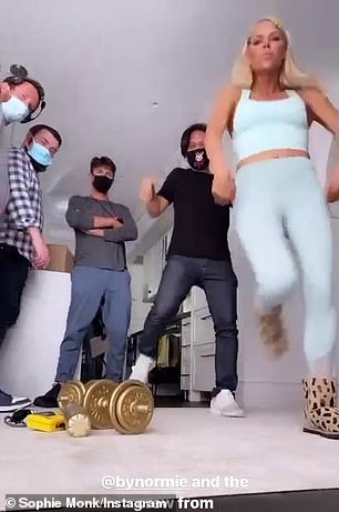She's got the moves: Her ample assets almost spilled out of her top during a photo shoot as she performed several moves alongside masked-up crew members. She was joined by celebrity makeup artist Normie Gonzales during the dance and they swayed their hips to the pop track