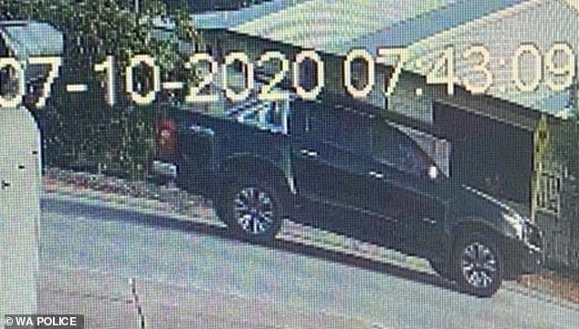 A black 4WD ute (pictured) was also seen in the area at 7.40am, and police hope to speak with the driver