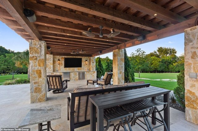 The estate has two outdoor viewing areas with built-in flat-screen TVs and comfy chairs. It's the perfect place to catch a game or a movie at home