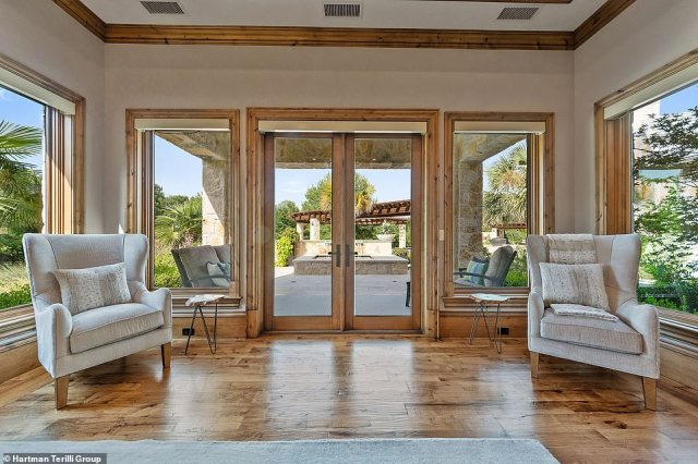 Huge floor-to-ceiling windows throughout the house let the light in to create an airy feel, while electric shades keep the heat out when necessary