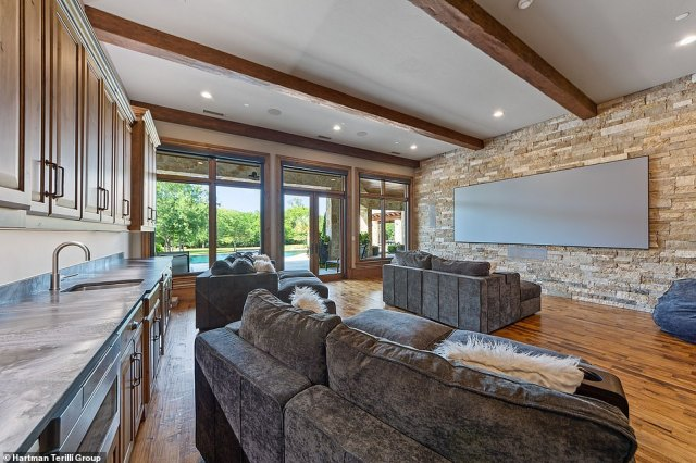 Another perfect space for entertaining indoors, the huge television makes this the ideal spot for a cozy movie night