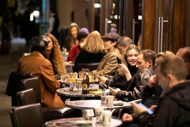 Under Tier Two restrictions, pubs and restaurants can remain open but households cannot mix indoors and they must close at 10pm. Pictured: Pub-goers enjoy the final night out before tighter restrictions in Soho, London