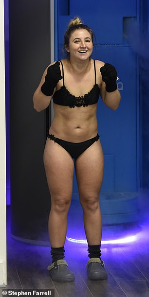 Looking good: The TV star looked confident as she showed off her taut midriff and toned legs in the skimpy black two-piece with lace detailing
