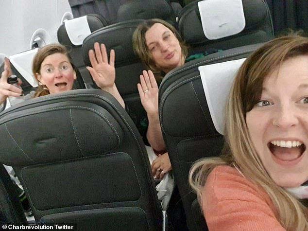 Above, Charisse poses with two women after they refused to wear face masks on their flight
