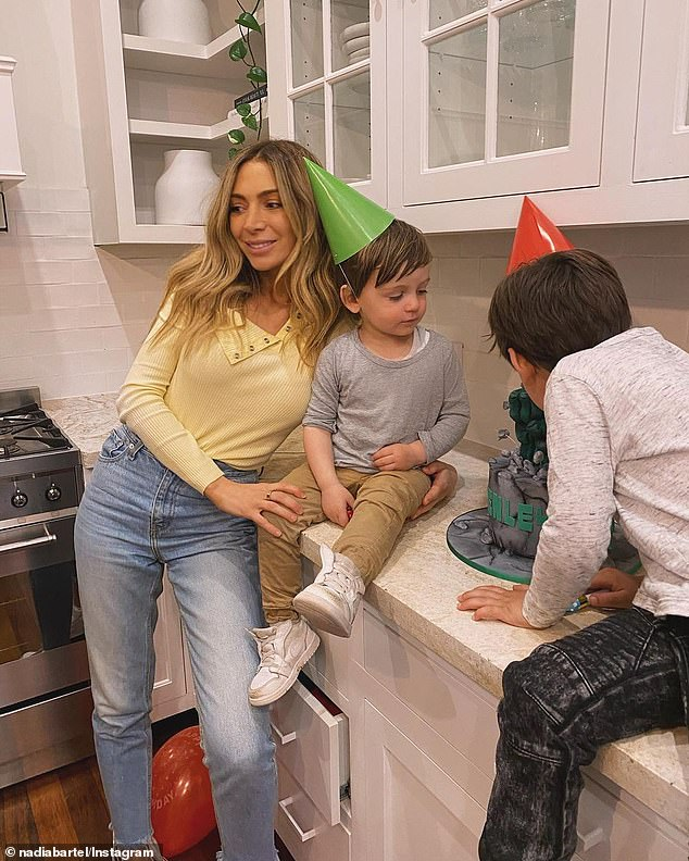 Happy birthday!Nadia Bartel and her sons are hunkered down in Melbourne - which has been hard hit by the pandemic in recent months. But that didn't stop the former WAG making the best of her son Henley's second birthday. Pictured with sons Henley and Aston
