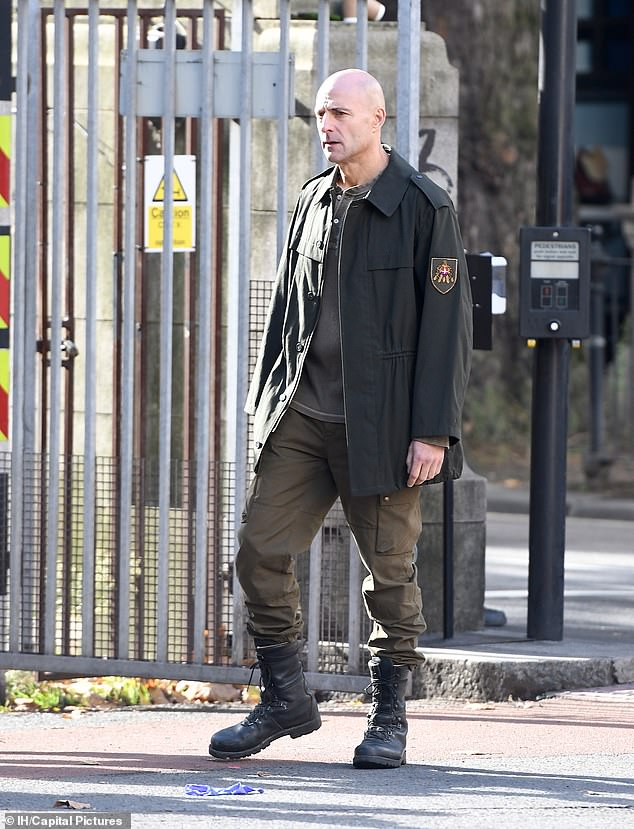 He's back: Mark Strong was pictured on set on Sky One's mini-series Temple on Friday, as filming resumed after a forced five month hiatus due to the pandemic