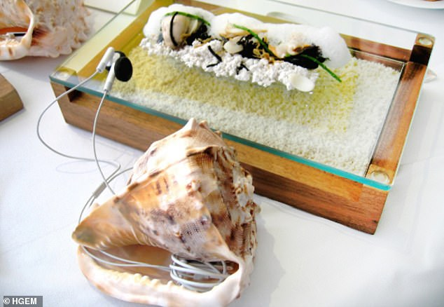 Heston Blumenthal's Sounds of the Sea dish, which consists of sashimi, tapioca 'sand' and sea foam, served with a conch shell containing an iPod gently playing the sounds of sea gulls and waves falling against the sand