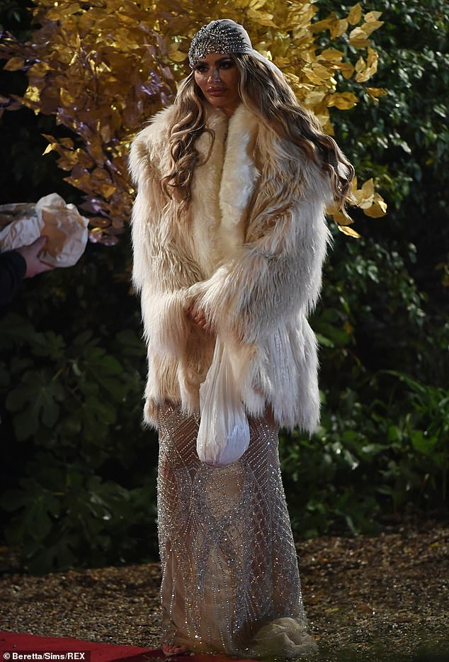 Wrapped up: Chloe added some warmth to her barely-there ensemble with a faux fur jacket