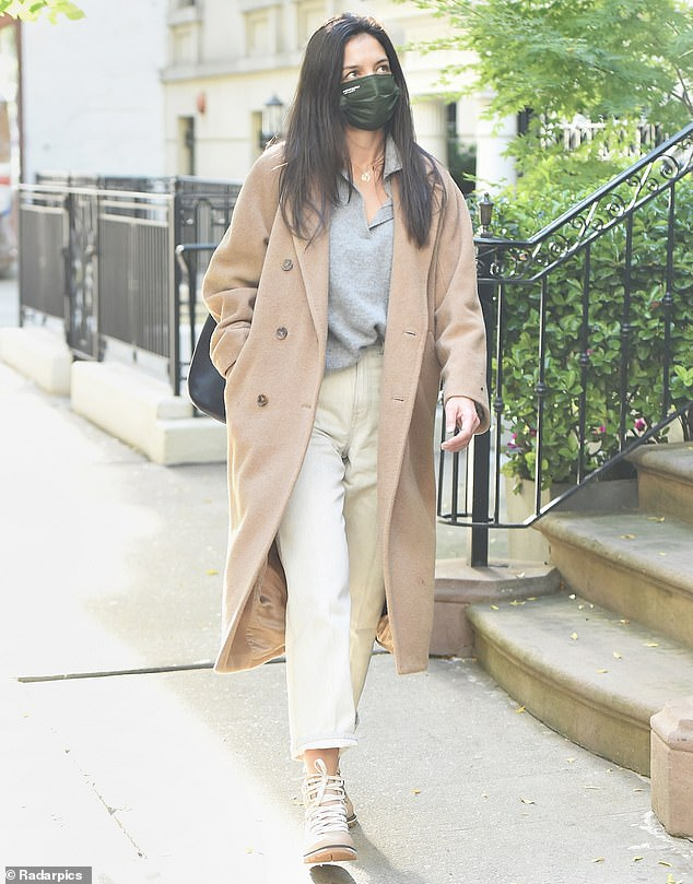 A step in the right fashion direction:The 41-year-old The Secret actress was seen in a camel colored power winter coat as she strolled alone in a residential area of the Big Apple