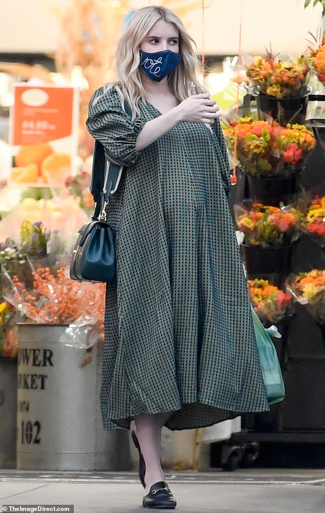 Chic comfort: The Scream Queens star kept it comfortable in the flowing dress and Gucci mules as she made her way out of the store