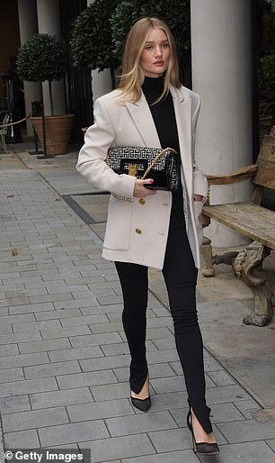 Chic: Rosie looked effortlessly chic in a designer cream blazer adorned with gold buttons