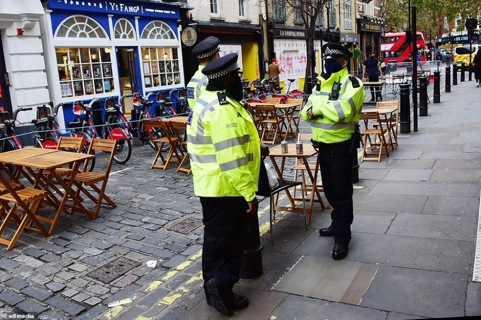 Deputy Assistant Commissioner Matt Twist, the Met's lead for the Covid-19 crisis, told the Evening Standard : 'This is a critical moment in London's fight against this deadly virus.' Pictured, police officers in Soho