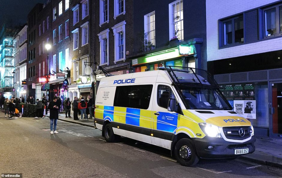 A police van parked on the side of the road in Soho. Police officers are out in force tonight to ensure social distancing is maintained and other coronavirus rules are adhered to