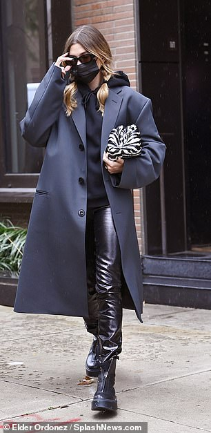 Incognito: The 23-year-old model bundled up against the fall chill in a dark ensemble consisting of leather pants and some chunky boots.