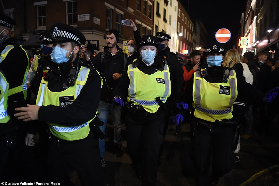 Police officers marched through Soho as they tried to break up illegal gatherings of more than six people in central London