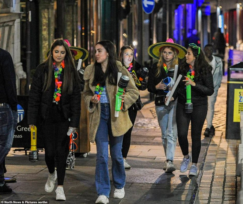 A group of six women all hold blow-up microphones and don sombreros for a night out in Newcastle on Friday night