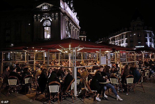 The governmentwill spend another 1 billion euros to help businesses hit by the new restrictions as cities including Lille (pictured) face a strict 9pm curfew to curb new cases