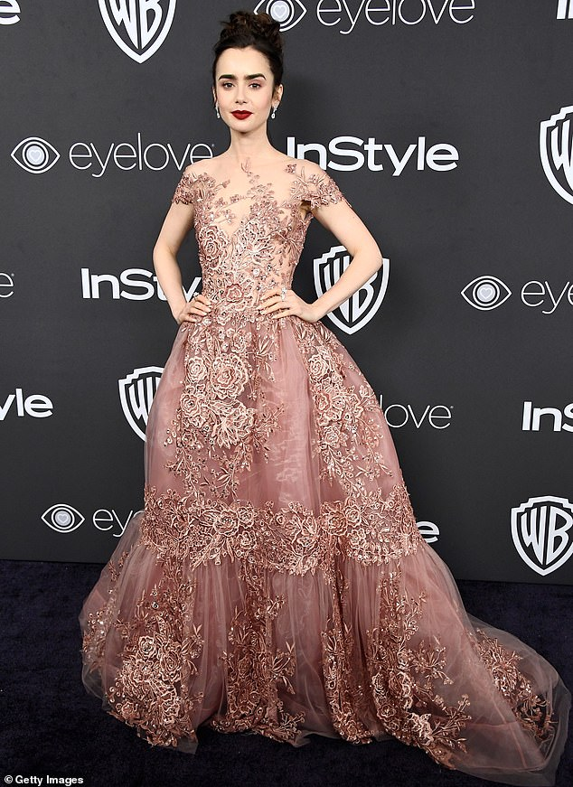 Lily Collins, who has five tattoos including an English rose on her foot, favours an edgy, slightly gothic look created for her by J-Lo's styling duo Rob Zangardi and Mariel Haenn. She made a huge impact at the 2017 Golden Globe Awards when she wore a stunning Zuhair Murad pink lace gown (above)