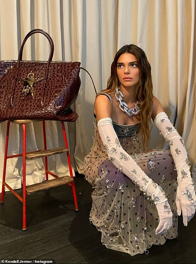 At home:Kendall Jenner shared more shots modeling a sheer gown from Givenchy's latest collection to Instagram