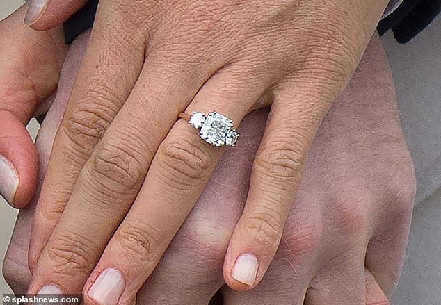 Prince Harry proposed to Meghan in November 2017 with a glittering ring comprising of a solid yellow gold band set with three diamonds, pictured