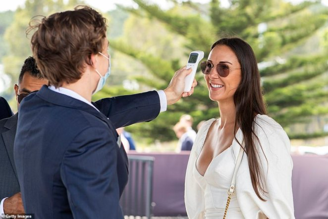 Temperature check: Patrons were asked to have their temperatures checked before they entered the Royal Randwick racecourse on Saturday