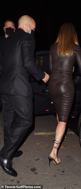 Looking good:Meanwhile, Jason looked dapper in an all-black ensemble, and like Rosie, covered up with a black face mask