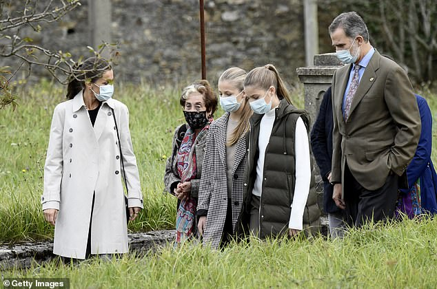 Queen Letizia, 48, left, recycled an off-white Burberry trench coat which she previously wore in 2018. Pictured with her husband and two daughters